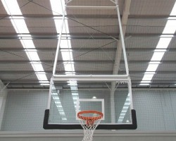 Basketball under backboard padding for indoors