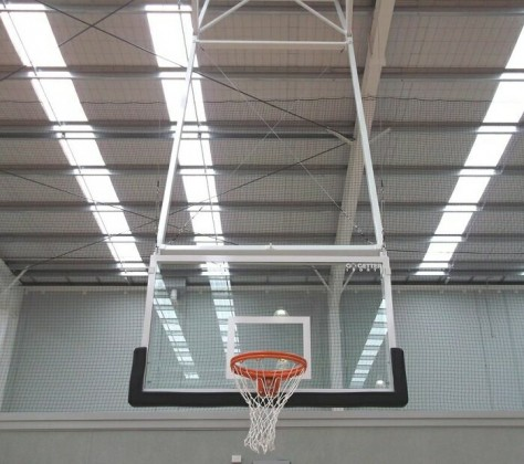 Basketball under backboard padding for indoors