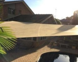 Shade sail over pool
