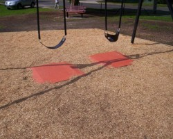 Rubber soft pads under play equipment fall zones